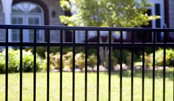 A black basic steel fence panel with three horizontal rails