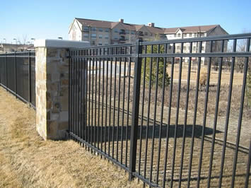 Black basic steel fencing are installed to secure a premise.