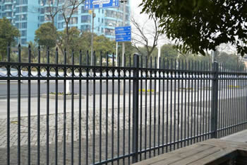 Black steel security fences are used at the roadside to protect surround estates.