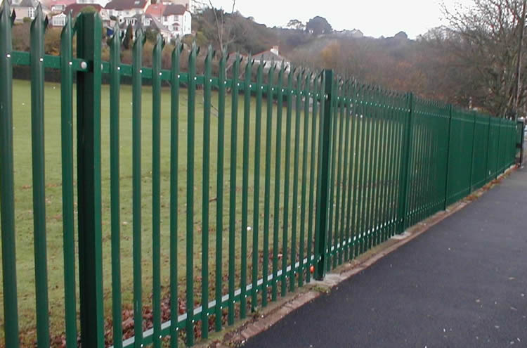 Green painted steel palisade fencing is used to secure premises.