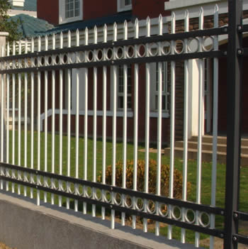 Steel security fences with white pickets, black post and rails are installed to secure a house estate.