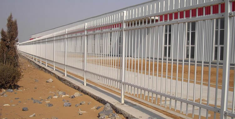 White steel security fencing are installed around the factory.